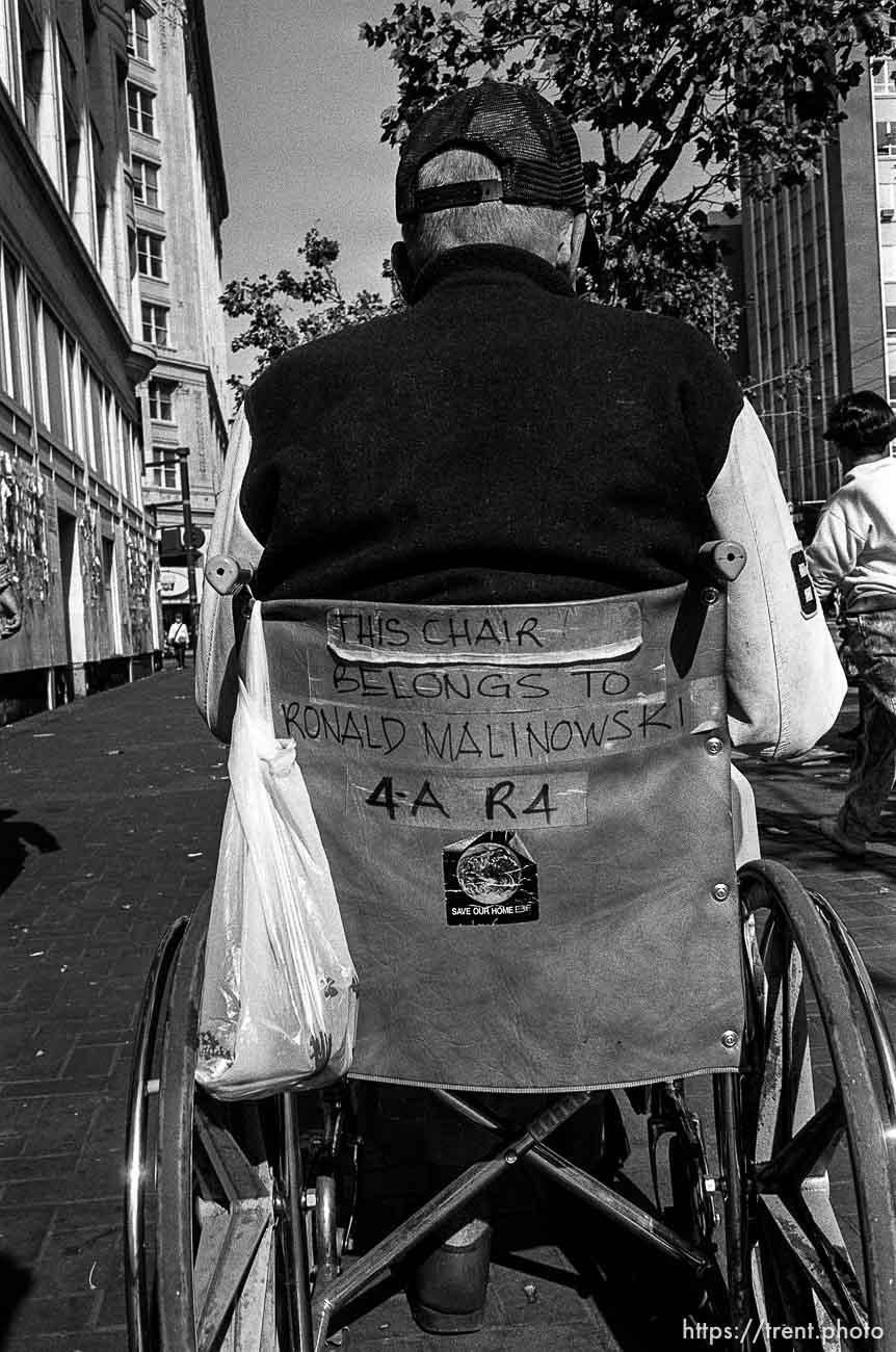Man in wheelchair. Leica hip shots on the street.