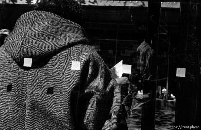 Man's back. Leica hip shots on the street.