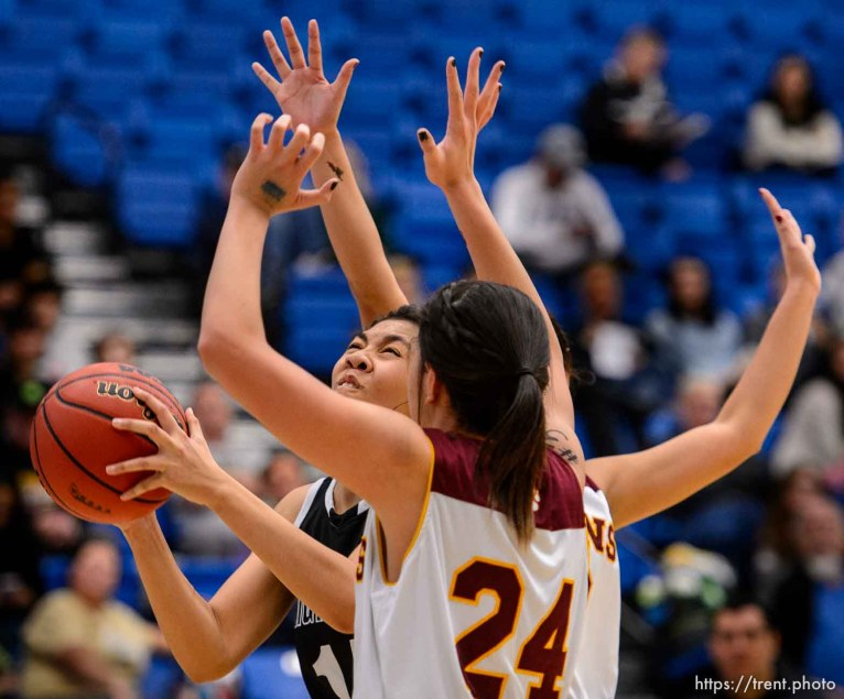 Trent Nelson | The Salt Lake Tribune Highland's Lea Havili (14) looks for a shot, defended by Mountain View's Paulani Tarawa (24), as Mountain View faces Highland in the 4A state basketball tournament at Salt Lake Community College in Taylorsville, Tuesday February 17, 2015. Mountain View wins 54-49.