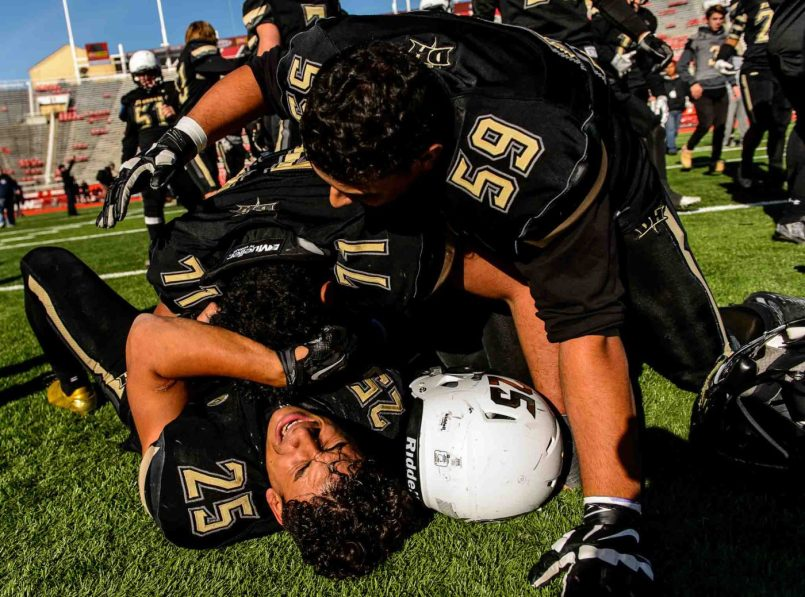 Trent Nelson | The Salt Lake Tribune Desert Hills' Marco Jordan (25), Laisene Sewell (71) and Adeeb Jaouni (59) celebrate the win as Desert Hills faces Pine View in the Class 3AA high school football state championship at Rice-Eccles Stadium in Salt Lake City, Friday November 18, 2016.