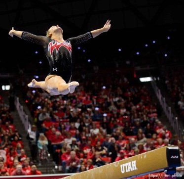 (Trent Nelson | The Salt Lake Tribune) Maddy Stover on beam as Utah hosts Washington, NCAA gymnastics in Salt Lake City, Saturday February 3, 2018.