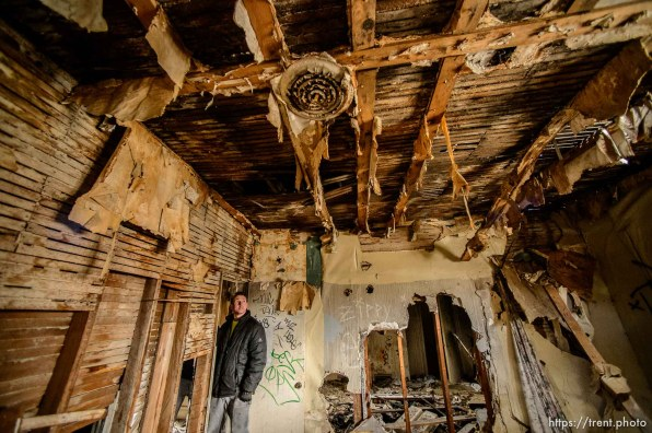 (Trent Nelson | The Salt Lake Tribune) Jordon Holdaway in a dilapidated, fire-damaged building near 100 South 700 East in Salt Lake City, Thursday Feb. 15, 2018. Other Side Academy has received approval to demolish it for their expansion.