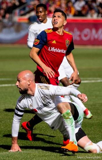 Real Salt Lake forward Jefferson Savarino (7) and Los Angeles FC defender Laurent Ciman (23) look back at the ball after Ciman defleted Savarino's shot.