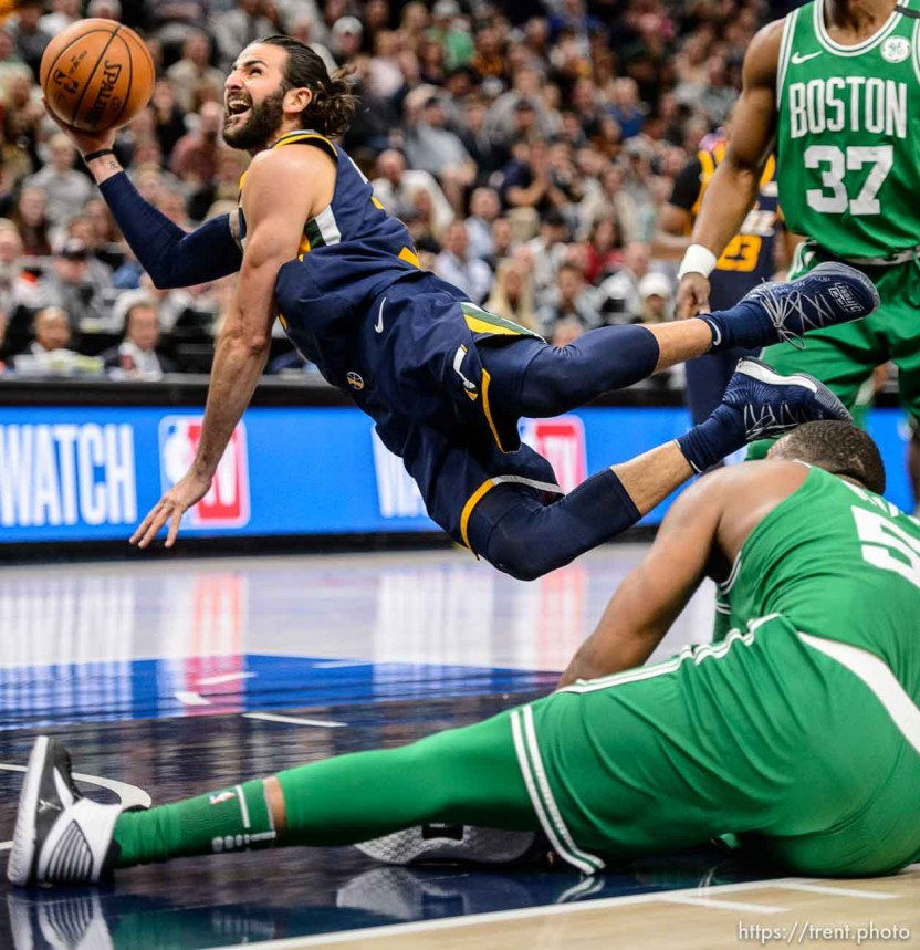 (Trent Nelson | The Salt Lake Tribune) Utah Jazz vs. Boston Celtics, NBA basketball in Salt Lake City, Wednesday March 28, 2018. Utah Jazz guard Ricky Rubio (3) shoots while falling.