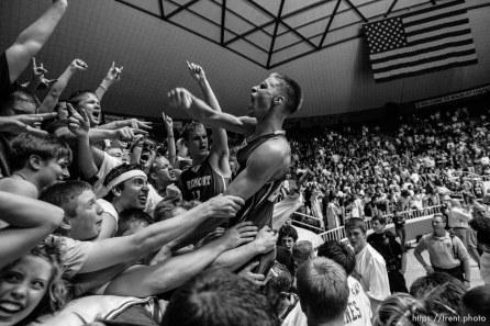 Fremont's Joel Hancock lets out a scream, celebrating Fremont's state championship win over West Jordan. At center is Fremont's Austin Raught. Fremont vs. West Jordan, 5A state high school basketball championship game Saturday at Weber State University, Ogden.
