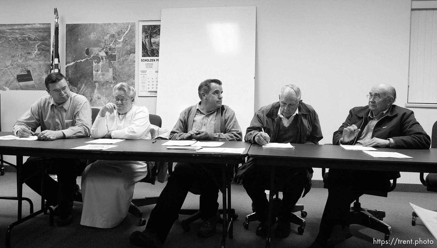 Colorado City Council left to right: Kimball Barlow (gray shirt), Karen Barlow (pink dress), Terrill Johnson, Bygnal Dutson, Floyd Black, Donald Richter.