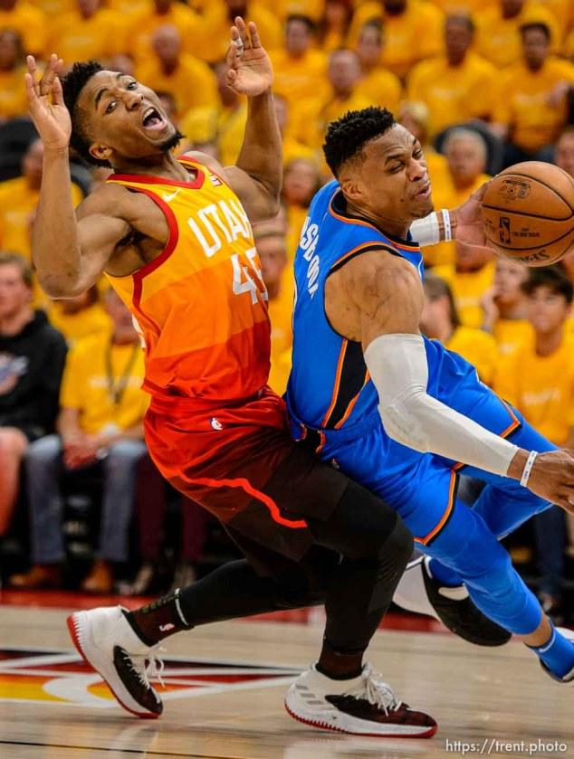 (Trent Nelson | The Salt Lake Tribune) Utah Jazz host the Oklahoma City Thunder, Game 3, NBA playoff basketball in Salt Lake City, Saturday April 21, 2018. Utah Jazz guard Donovan Mitchell (45) fouls Oklahoma City Thunder guard Russell Westbrook (0).