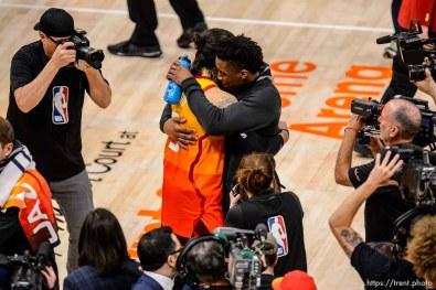 (Trent Nelson | The Salt Lake Tribune) Utah Jazz host the Oklahoma City Thunder, Game 3, NBA playoff basketball in Salt Lake City, Saturday April 21, 2018. Utah Jazz guard Ricky Rubio (3) and Utah Jazz guard Donovan Mitchell (45) embrace.
