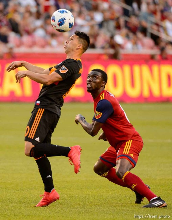 (Trent Nelson | The Salt Lake Tribune) Houston Dynamo midfielder Tomas Martinez (10) and Real Salt Lake midfielder Stephen Sunny Sunday (8) as Real Salt Lake hosts Houston Dynamo, MLS Soccer at Rio Tinto Stadium in Sandy, Utah, Wednesday May 30, 2018.