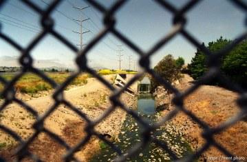 Creek, through chain-link