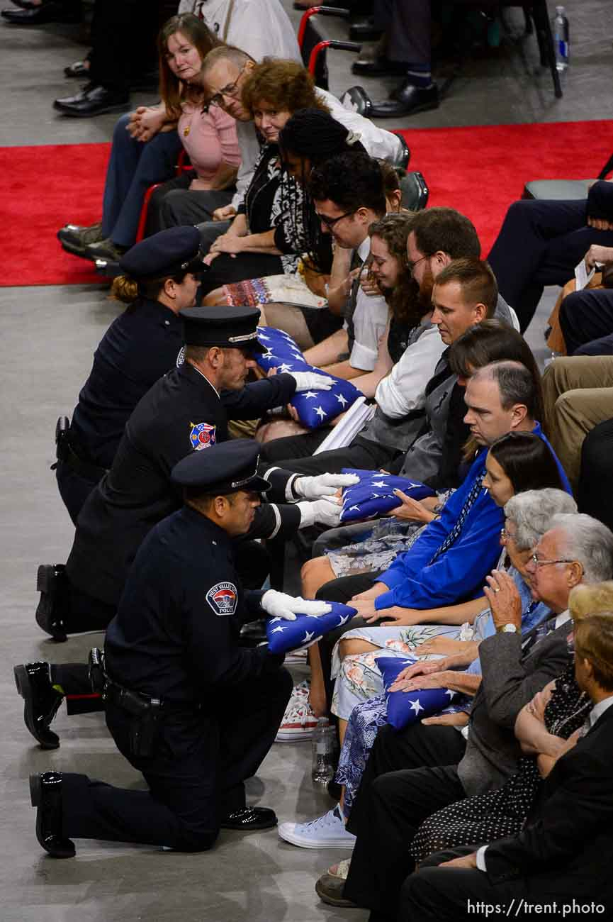 (Trent Nelson | The Salt Lake Tribune) West Valley City police officers perform a flag presentation for family members at funeral services for Jill Robinson, a West Valley City code-enforcement officer killed on the job last week. The service took place at the Maverik Center in West Valley City on Friday Aug. 17, 2018.