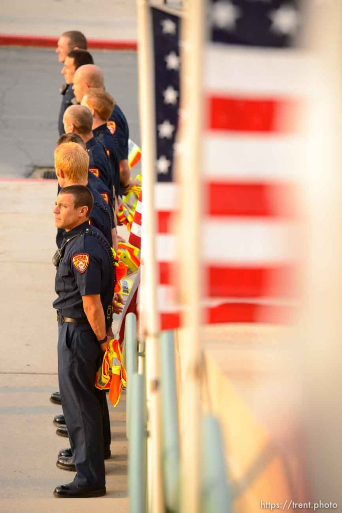 (Trent Nelson | The Salt Lake Tribune) Firefighters gather for the funeral services for Battalion Chief Matthew Burchett at the Maverik Center in West Valley City, Monday Aug. 20, 2018.