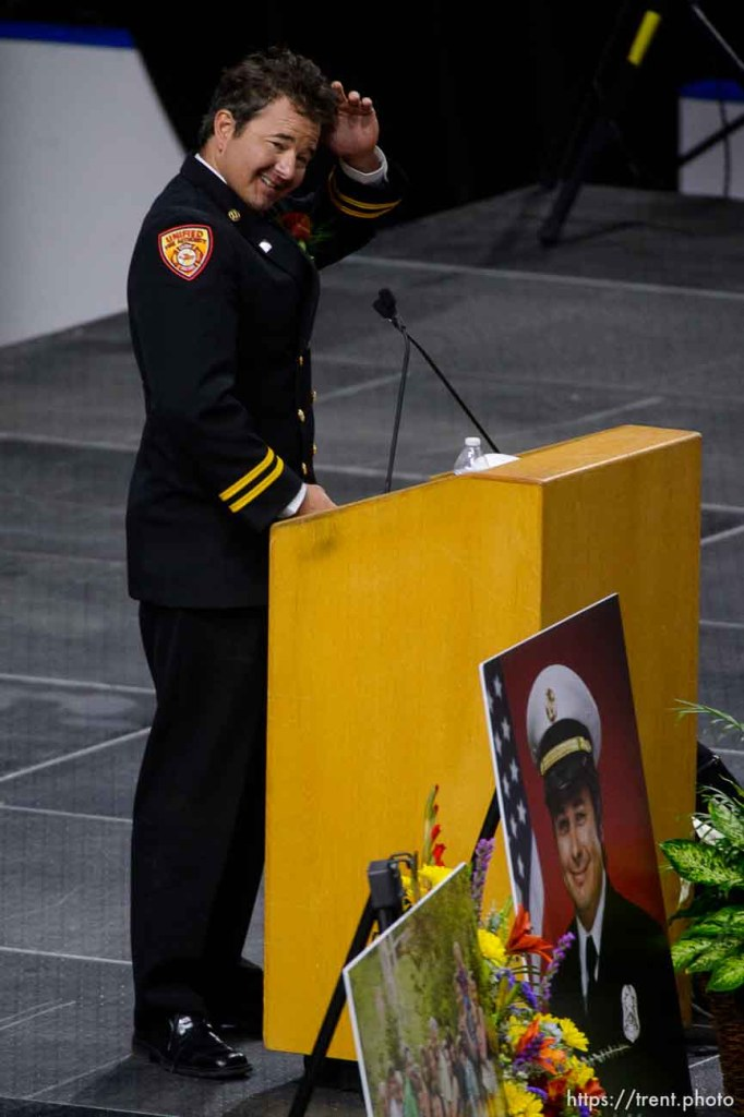 (Trent Nelson | The Salt Lake Tribune) Dominic Burchett (brother) ruffles his hair while speaking at the funeral services for Battalion Chief Matthew Burchett at the Maverik Center in West Valley City, Monday Aug. 20, 2018.