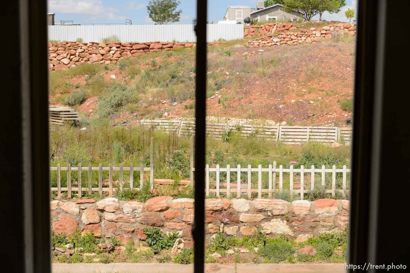 Trent Nelson | The Salt Lake Tribune window view, uep home after flds family fled before eviction, Monday May 8, 2017.