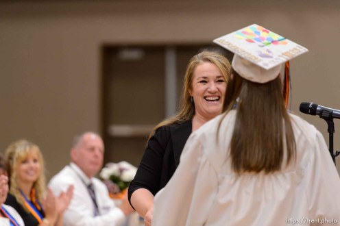 Trent Nelson | The Salt Lake Tribune shirlee draper presents uep trust scholarship to amy barlow at Water Canyon High School's graduation ceremony in Hildale, Monday May 22, 2017. Two years ago the school had one graduate, this year twenty-five.