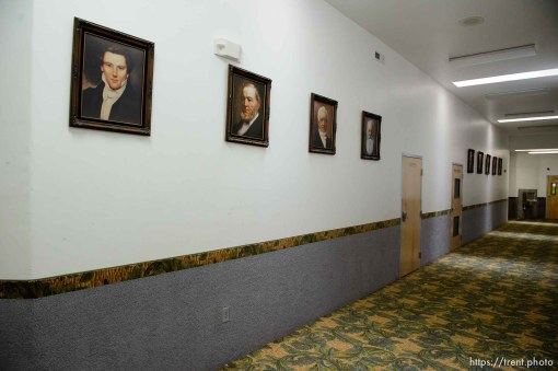 Trent Nelson | The Salt Lake Tribune Portraits of Mormon prophets including Joseph Smith and Brigham Young line the hallway in an FLDS school in Colorado City, Ariz., one of a few sites being considered for use as an LDS meetinghouse. The property is owned by the UEP land trust, which is seeking to dispose of its holdings. Tuesday May 23, 2017.