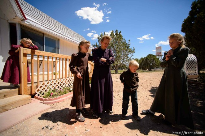 Trent Nelson | The Salt Lake Tribune LeAnne Johnson and her children at their new Cedar City home, Wednesday May 24, 2017. The Johnson family relocated to Cedar City after being evicted from UEP Trust properties in Hildale and Colorado City three times. Children are: Larissa (12, green dress), RosaLe (10, brown dress), Janice (8, dark pink dress), Melinda (6, pink dress), and Willis (4).
