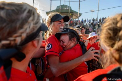 Trent Nelson | The Salt Lake Tribune Spanish Fork's Cambrie Hazel, left, is embraced by teammate Gabby Beckstrom as Spanish Fork defeats Uintah High School in the Class 4A softball state title game in Taylorsville, Thursday May 25, 2017.