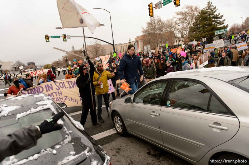 (Trent Nelson | The Salt Lake Tribune) Protesters clash with motorists after blocking off an interception after a rally against a visit by President Donald Trump, Monday December 4, 2017.