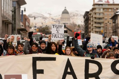 (Trent Nelson | The Salt Lake Tribune) Protesters block off an intersection downtown after a rally against a visit by President Donald Trump, Monday December 4, 2017.