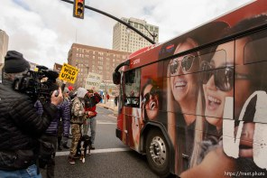(Trent Nelson | The Salt Lake Tribune) Protesters let a bus through an intersection they had blocked off downtown after a rally against a visit by President Donald Trump, Monday December 4, 2017.