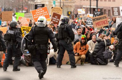 (Trent Nelson | The Salt Lake Tribune) Protesters and police meet downtown after a rally against a visit by President Donald Trump, Monday December 4, 2017.