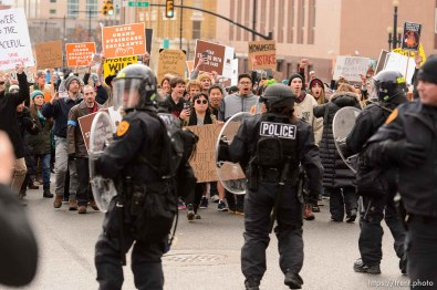 (Trent Nelson   The Salt Lake Tribune) Police back up as protesters approach downtown after a rally against a visit by President Donald Trump, Monday December 4, 2017.