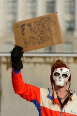 (Trent Nelson | The Salt Lake Tribune) A man who wished to remain anonymous holds a sign as protesters gather before a visit by President Donald Trump, Monday December 4, 2017.