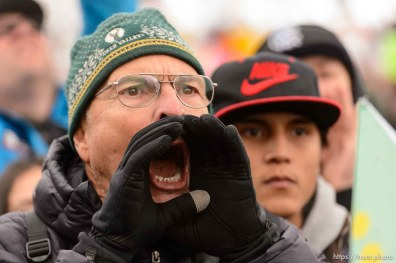 (Trent Nelson | The Salt Lake Tribune) A man tries to shout down a counter-protester at a rally against a visit by President Donald Trump, Monday December 4, 2017.