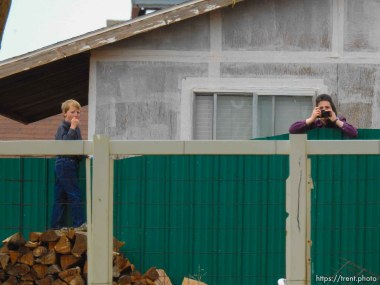 Trent Nelson | The Salt Lake Tribune An FLDS girl photographs as the locks are changed on an empty home in Colorado City, AZ, Tuesday May 9, 2017.