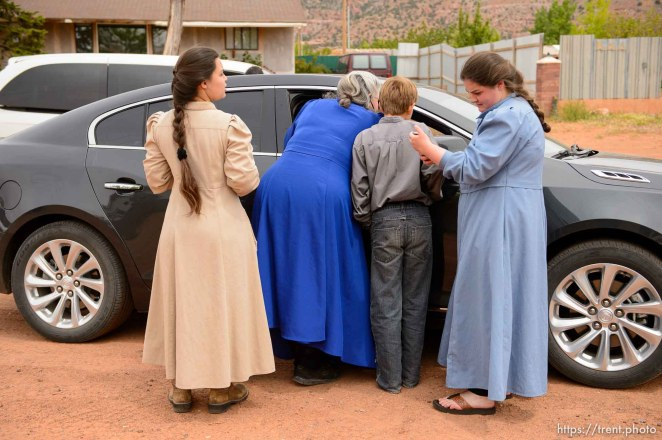 Trent Nelson   The Salt Lake Tribune An FLDS woman confronts UEP agent Ted Barlow and Mohave County Constable Mike Hoggard as they evict her from her home in Colorado City, AZ, facing eviction, Tuesday May 9, 2017. Locksmith Kelvin Holdaway in blue shirt. Onlookers