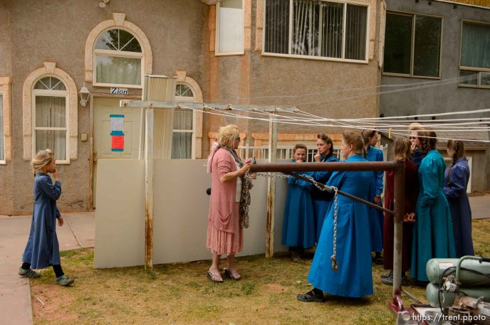 Trent Nelson   The Salt Lake Tribune Christine Marie Katas talks with FLDS women and girls about housing options as they're evicted from their Colorado City, AZ, home, Tuesday May 9, 2017.