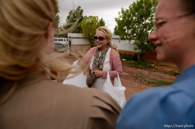 Trent Nelson   The Salt Lake Tribune Christine Marie Katas hands out relief kits to FLDS women in Colorado City, AZ, Tuesday May 9, 2017, as the locks are changed on the home next door by the UEP Trust.