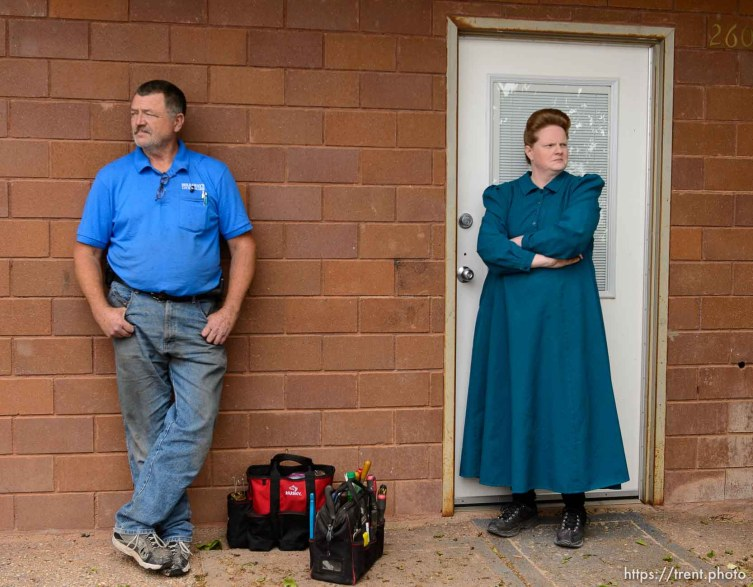 Trent Nelson | The Salt Lake Tribune Locksmith Kelvin Holdaway and FLDS member Julia Johnson stand outisde of her Colorado City, AZ, property awaiting the outcome of a confrontation over her eviction, Tuesday May 9, 2017. Johnson was given more time to stay on the property before her eviction.