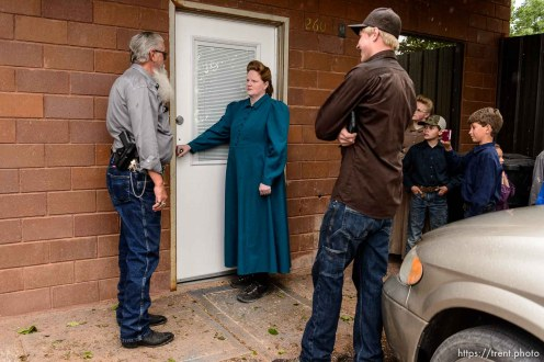 Trent Nelson | The Salt Lake Tribune FLDS member Julia Johnson confronts Mohave County Constable Mike Hoggard, disputing the UEP Trust's ability to evict her from a property in Colorado City, AZ, Tuesday May 9, 2017.