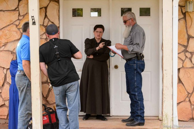 Trent Nelson   The Salt Lake Tribune An FLDS woman confronts UEP agent Ted Barlow and Mohave County Constable Mike Hoggard as they evict her from her home in Colorado City, AZ, facing eviction, Tuesday May 9, 2017.