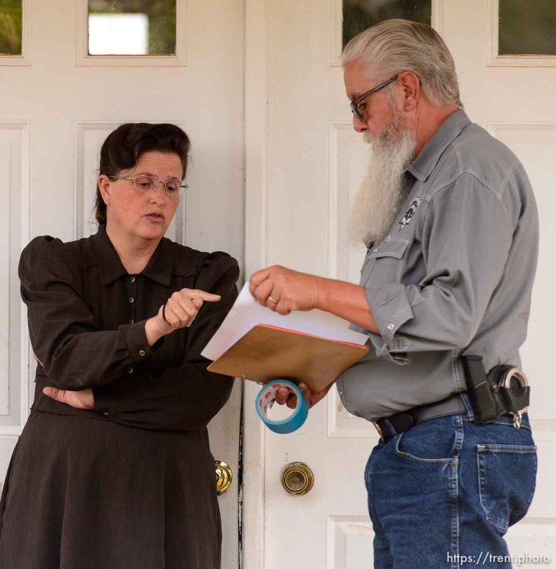 Trent Nelson | The Salt Lake Tribune An FLDS woman confronts Mohave County Constable Mike Hoggard as he evicts her from a home in Colorado City, Ariz., Tuesday May 9, 2017.