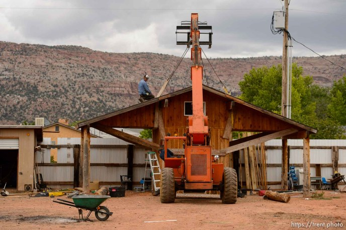 Trent Nelson   The Salt Lake Tribune An FLDS man struggles to remove a shed from a Colorado City, AZ, home as the UEP Trust evicts him, Tuesday May 9, 2017.