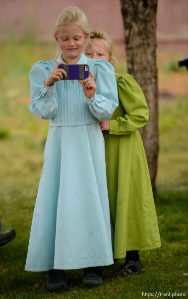Trent Nelson | The Salt Lake Tribune An FLDS girl takes video of the scene as her family is evicted from their Colorado City, AZ, home, Tuesday May 9, 2017.