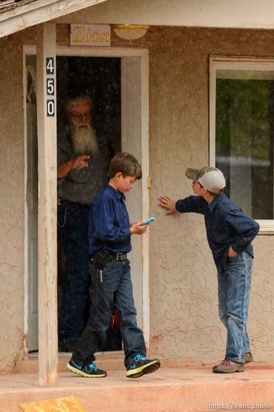 Trent Nelson | The Salt Lake Tribune Mohave County Constable Mike Hoggard orders FLDS boys away from a Colorado City, AZ, home where the locks are being changed, Tuesday May 9, 2017. One of the boys had been taking videos of the eviction process.