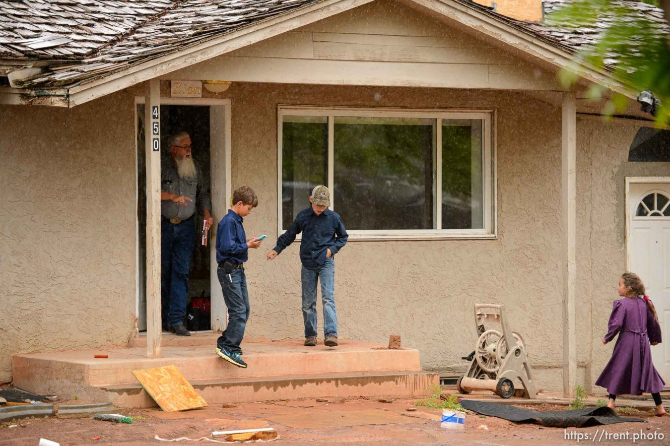 Trent Nelson   The Salt Lake Tribune The locks are changed on an empty home in Colorado City, AZ, Tuesday May 9, 2017, as part of the UEP Trust evictions. FLDS children take videos of the work of locksmith Kelvin Holdaway, and are then ordered off the property by Mohave County Constable Mike Hoggard.