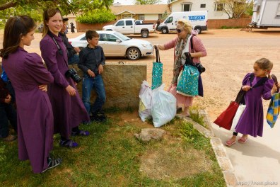 Trent Nelson | The Salt Lake Tribune Christine Marie Katas hands relief kits to FLDS children facing eviction Colorado City, AZ, Tuesday May 9, 2017.