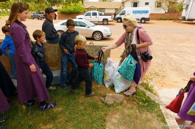Trent Nelson   The Salt Lake Tribune Christine Marie Katas hands relief kits to FLDS children facing eviction Colorado City, AZ, Tuesday May 9, 2017.