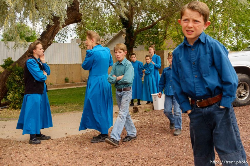 Trent Nelson   The Salt Lake Tribune FLDS women and children stand in the yard of their Colorado City, AZ, home as they are evicted, Tuesday May 9, 2017.
