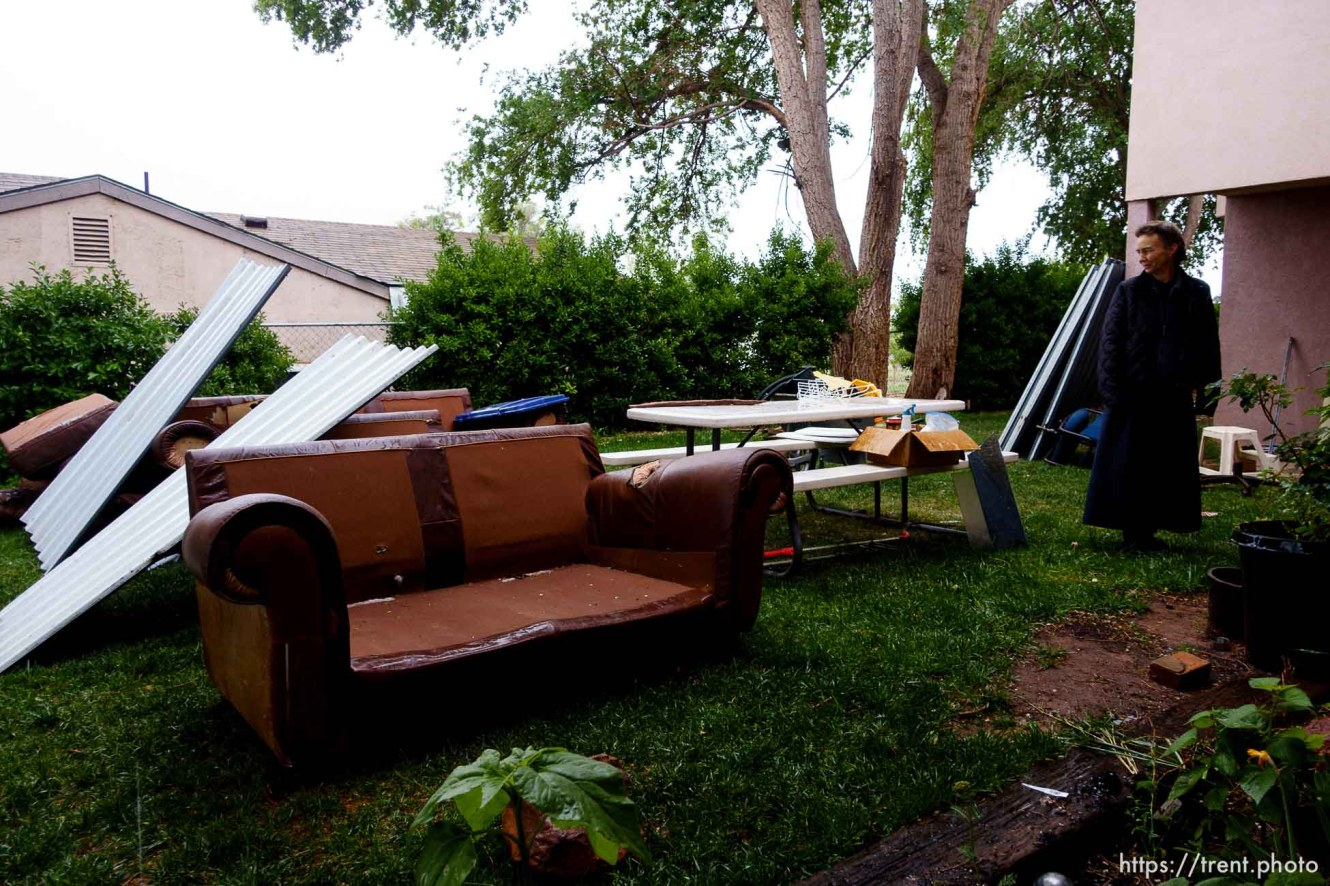 Trent Nelson   The Salt Lake Tribune UEP eviction of property at 555 N Lauritzen Ave, Colorado City, AZ, Wednesday May 10, 2017. FLDS single mother Liz with some of her belongings on the lawn, in the rain.