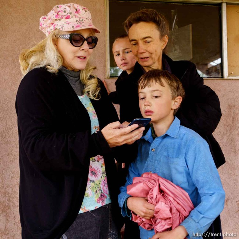 Trent Nelson   The Salt Lake Tribune Christine Marie Katas, left, looks up possible apartments for an FLDS mother named Liz and two of her children, Joesph and Mary Anne, as she is evicted from her Colorado City, AZ, home by the UEP Trust, Wednesday May 10, 2017. The FLDS choose to not use the Internet, but will use information that friendly non-members look up for them.