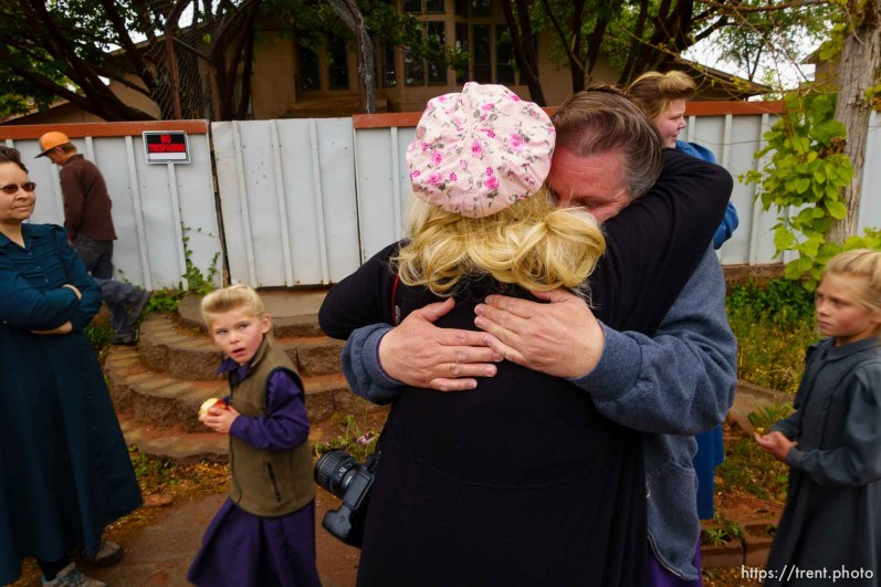Trent Nelson | The Salt Lake Tribune Christine Marie Katas embraces an FLDS woman evicted. UEP eviction of property at 345 N Richard St, Colorado City, AZ, Wednesday May 10, 2017.