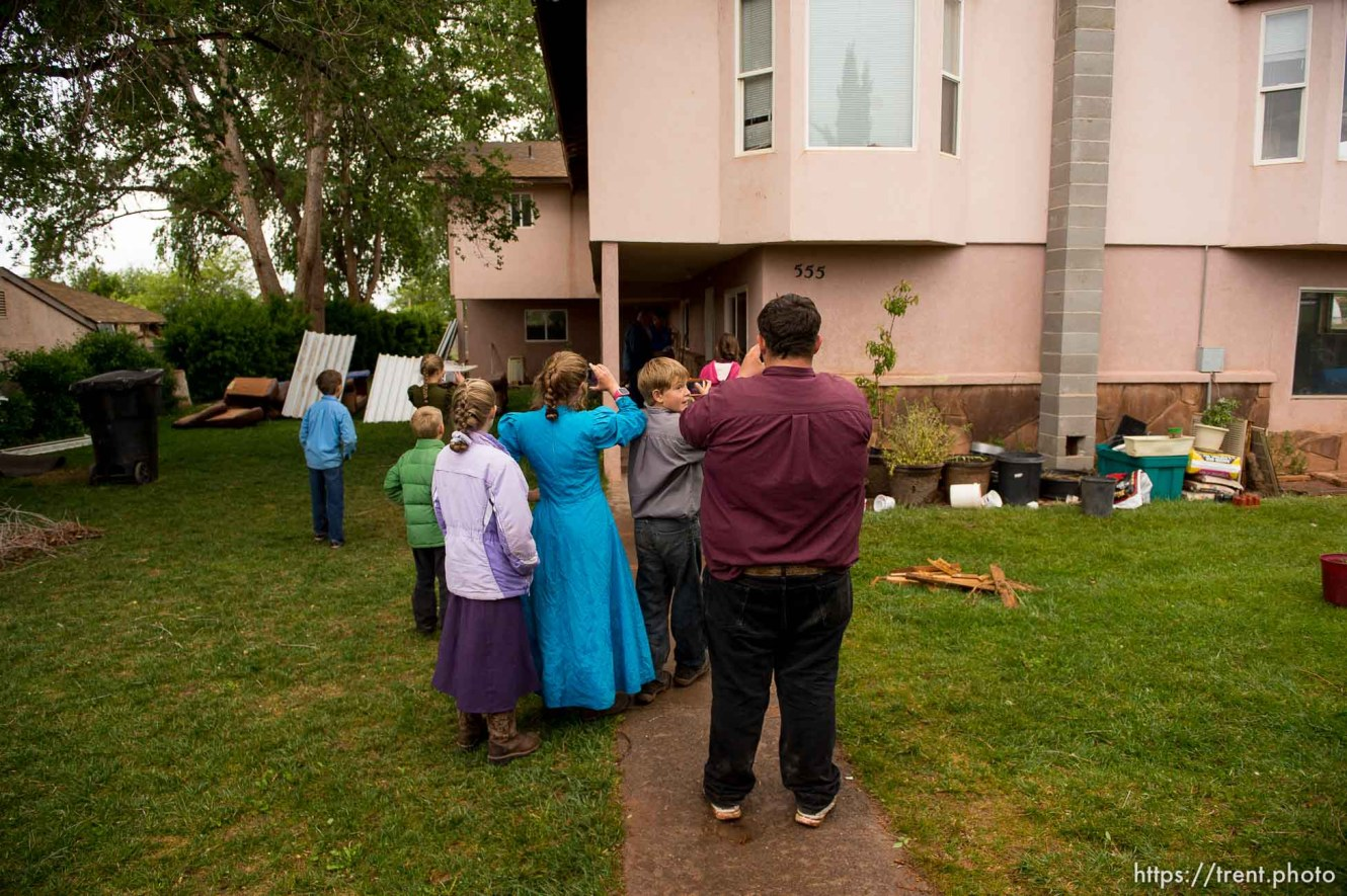 Trent Nelson   The Salt Lake Tribune FLDS children film a locksmith during the UEP eviction of property at 555 N Lauritzen Ave, Colorado City, AZ, Wednesday May 10, 2017.