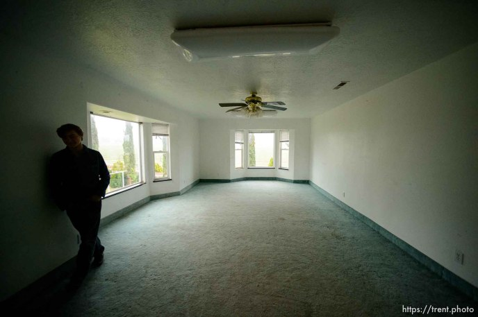 Trent Nelson | The Salt Lake Tribune flds boy in home at 555 N Lauritzen Ave, Colorado City, AZ, Wednesday May 10, 2017. UEP evicted this property shortly after photo was taken.