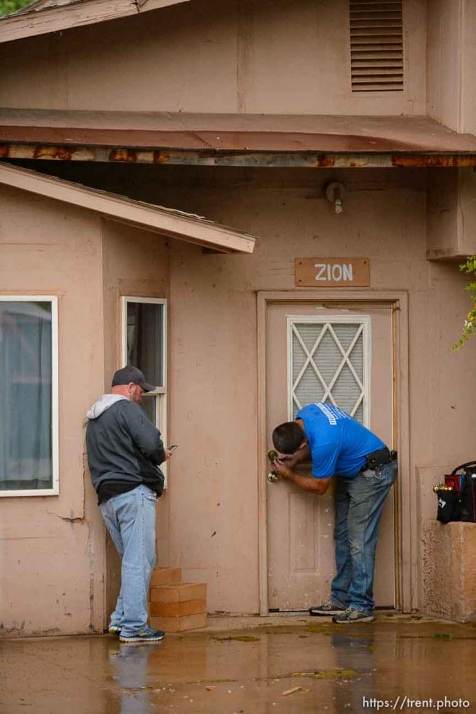 Trent Nelson | The Salt Lake Tribune UEP eviction of property at 345 N Richard St, Colorado City, AZ, Wednesday May 10, 2017. Ted Barlow, locksmith Kelvin Holdaway.